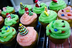 Holiday cupcakes with snowmen, Santa Claus, Christmas trees, and M