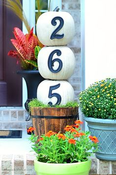 House Numbers Pumpkin Topiary. An easy fall front porch project that anyone can do! @A T The Picket Fence