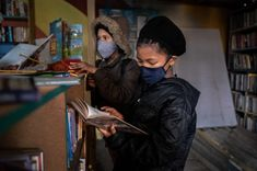 PHOTOS: Joy Of Books In Cape Town Library Born In Shipping Containers : Goats and Soda : NPR Library Rules, Used Shipping Containers, Library Design, High School Musical, A Guy Who, Book Projects, Slums, Book Nooks, Cape Town