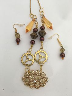 Steampunk Style at its finest. Check it out here! http://www.thebrasscaliper.com/products/repurposed-gold-gramma-pin-necklace-earrings-set?utm_campaign=social_autopilot&utm_source=pin&utm_medium=pin
