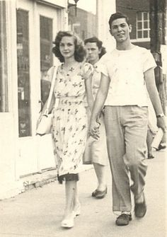 Street Fashion, Young couple, 1940s.....is her slip showing?.......he looks so comfortable