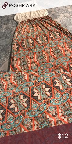 Tribal print maxi dress Tribal print maxi dress, in blues, and orange. Cream top with a Razorback. Dress is a pink republic size large. Dress is pre-owned Dresses Maxi