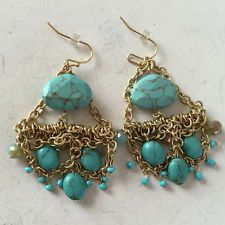Gold plated dangling earrings with turquoise color beads and faceted c... Lot 45