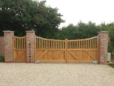Wooden garden gates and timber doors can be made to your requirements by our carpenters and craftsmen. Bespoke timber construction in Suffolk, Norfolk, Essex and Cambridgeshire Brick Columns Driveway, Driveway Entrance, Entrance Gates, Backyard Patio Designs, Backyard Fences, Garden Fences, Wooden Garden Gate, Wooden Gates, Garage Door Design