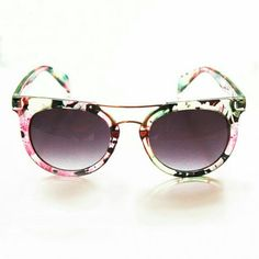 Grande Damme sunnies cateye sunglasses A pair of cateye sunglasses in a clear floral print plastic with metal nose bar. Gray lens with slight ombre effect. Vera Lyndon Accessories Sunglasses