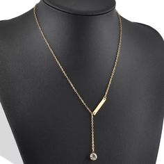 Gold Bar Necklace NWOT Gold necklace with a bar and a clear rhinestone. The length can be adjusted by moving  the chain with the clear rhinestone as seen in the last picture. Jewelry Necklaces
