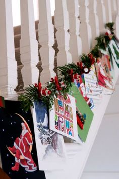 Staircase banisters decorated with Christmas decorations and cards