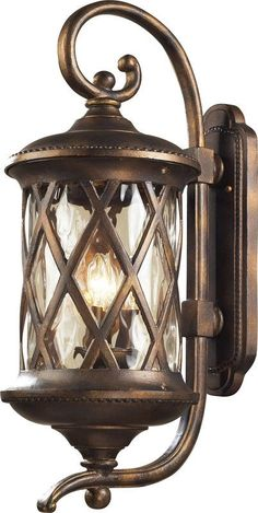 I have this tuscan style ntern on my garage front porch elk lighting 420323 barrington gate 3 light outdoor wall sconce hazelnut bronze outdoor lighting aloadofball Choice Image