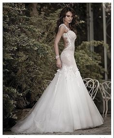 Love this gorgeous white wedding dress with a see through back