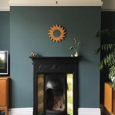 Paint color and fireplace Farrow & Ball Inchyra Blue - Lindy Ka. Farrow And Ball Living Room, Living Room Green, Paint Colors For Living Room, Home Living Room, Living Room Decor, Farrow Ball, Farrow And Ball Paint, Blue Bedroom, Bedroom Colors
