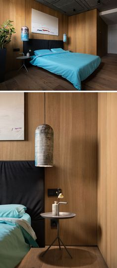 This modern guest bedroom has wood walls and floors, adds a punch of color with use of teal bedding and colorful pendant lights. A simple art piece hangs above the bed to break up the wood wall.