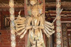 Kathmandu Changu Narayan 08 A Multi Armed Tantric Deity Carved In Wood On The Roof Strut On The South Side Of Changu Narayan Temple The roof strut on the south side of the Changu Narayan Temple in Kathmandu has an intricate carving of a multi-armed Tantric deity.