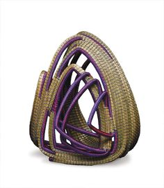 Debora Muhl created baskets, including this one with magenta ribbon highlights, as prizes for the 2008 Pennsylvania Governor's Awards | American Craft Council