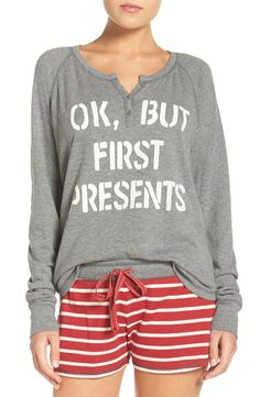 These classic thermal PJs take on a holiday vibe with playful graphics and candy cane stripes. A comfy oversized long-sleeve top with coordinating drawstring-waist shorts is perfect for lounging around the house.