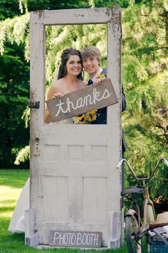 Vintage old door as a photo booth. Both rustic and shabby chic wedding.
