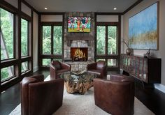 Contemporary Man Cave with stone fireplace, Hardwood floors, Crate and Barrel Driftwood Coffee Table