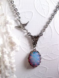 Winter's Blue Fire Opal Necklace With Bird by FashionCrashJewelry