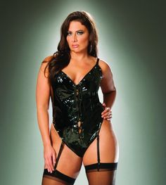 Lace up vinyl thong back teddy with studs. Adjustable and detachable garters.