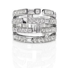 Traffic by Harry Winston, Four Row Diamond Ring. 54 round brilliant and baguette diamonds, approximately 1.39 total carats; platinum setting.