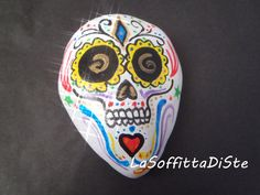 painted rock painted stone sugar skull calaveras acrylics halloween zombie white gold blue yellow black paperweight ooak lasoffittadiste