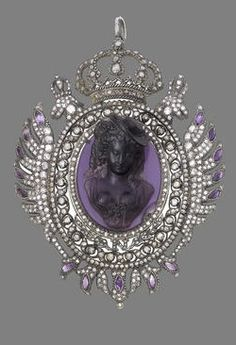 A paste and diamond pendant. Centrally-set with a paste relief carving of a young woman in contemporary dress, mounted in silver and gold. By repute, the pendant was made for Jospeh Bonaparte (1768-1844), Napoleon's oldest surviving brother. He was king of Naples and later king of Spain.