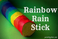 Rainbow Rain Stick Craft using paper towel tubes, rice, construction paper, and a little bit of ribbon-- easy peasy!
