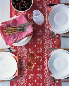 Rugged and practical, bandannas seem almost patriotic, so this table runner is fitting for your Fourth of July barbecue. Lay a bandanna flat (you'll need several matching ones).