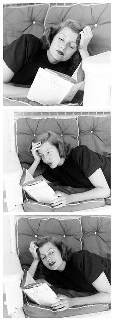 Rita Hayworth reading at home. Photographed by John Florea. October, 1948