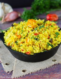 An aromatic rice dish seasoned up with saffron (turmeric) with carrots, peppers and raisins. Flavorful and delicious. An aromatic rice dish seasoned up with saffron (turmeric) with carrots, peppers and raisins. Flavorful and delicious. Yellow Rice Recipes, Dishes With Yellow Rice, Jamaican Rice, Jamaican Recipes, Seasoned Rice Recipes, Caribbean Recipes, Caribbean Rice, Carribean Food, Saffron Rice