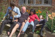 David Gilmour and family...and a broken bench.