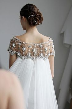 Look at the back of this! Happily Ever Borrowed would absolutely love to put some gorgeous accessories in this bride's hair!