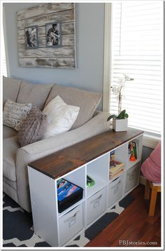 quick and easy kid storage  great idea since we will need the room in the living…