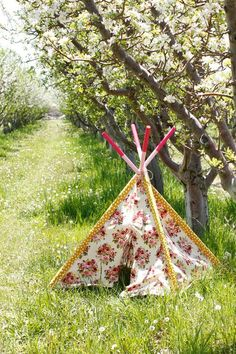 Like the decorated tops of sticks. DIY Kid's Teepee | And Then We Saved