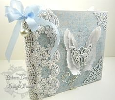 Step by step tutorial for a gorgeous no cutting, no measuring mini album.  Blue & white, lace, pearls, ribbons, butterflies Maja Papers