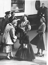 London: Princess Margaret curtsies to Queen Juliana of the Netherlands, when with Prince Bernhard, Queen Juliana arrived at Victoria Station (London) on her four-day State Visit to London. Watching the greeting are Princess Elizabeth (right), Queen E