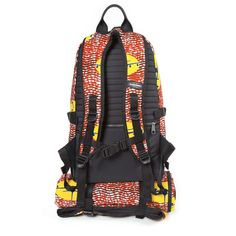 Eastpak Inspired by the World of Vlisco. Red African print backpack designed by Harvey Bouterse and made from unique Wax Hollandais material. Spring Summer 2015.