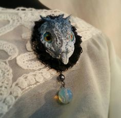 Dragon head brooch with black lace