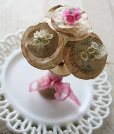 love the combo of the silk miniature flowers with the postcard flowers