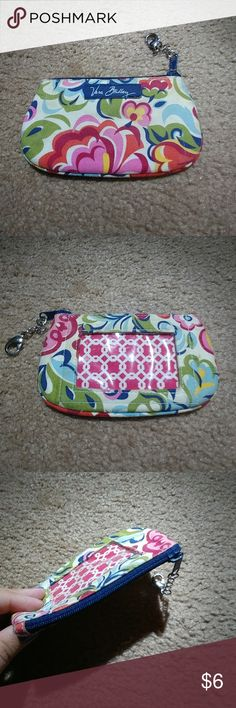 Vera Bradley ID holder Vera Bradley zipper ID and credit card holder. It has a nice clip that can be attached to your keys. The white on it is a bit dirty from gentle use but I'm sure it can be cleaned! Vera Bradley Bags Clutches & Wristlets