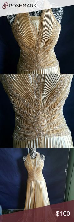 Final price reduction!! Stunning Gold Gown Just stunning, a radiant glowy silk flabric perfectly pleated and beaded. It would look wonderful with an old hollywood vintage makeup and hair look. It was altered to cover up the bust area but that can easily be removed without damage to the gown. Will make additional post with more deatails.  Has been dry cleaned and is ready to wear. Measuments: Bust:17 inches Waist: 15 inches Hips: free Length: 53 inches from underarm to hem. Dresses Prom