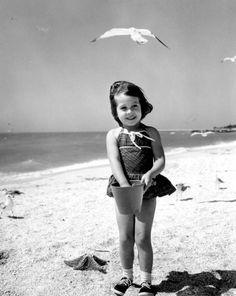 Donna Walwork enjoying the sun and sand on the beach in Sarasota (1965).   Florida Memory