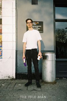 Men's street style | Tuck It In - Who knew simply tucking in your classic tee could give you so many style points? throw on a pair of retro glasses and a classic Timex watch to complete the look. | Shop the look at The Idle Man