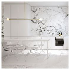 White Kitchen with marble walls and lucite chairs. Get started on liberating your interior design at Decoraid https://www.decoraid.com