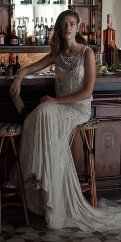 BHLDN Spring 2017 Wedding Dress | Take a step back into the glamourous Art Deco period in this exquisite blouson gown. One-of-a-kind beading bejewels the illusion neckline, cascading over the tulle overlay. Covered buttons run up the back for a feminine accent.