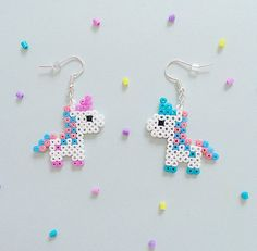Bubblegum Unicorn Hama Bead Earrings A few super-cute bubblegum pixel unicorn earrings, available in four kawaii pastel colors: - Pastel Pink Pastel B. Perler Bead Designs, Hama Beads Design, Diy Perler Beads, Hama Beads Patterns, Perler Bead Art, Beading Patterns, Art Perle, Motifs Perler, Peler Beads