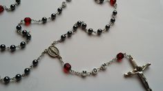 Close up of hematite and ruby cathedral beads.  BEAUTIFUL!