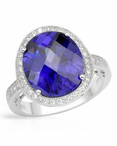 Our 13.69 CTW Tanzanite White Gold Rhodium / Sterling Silver Ring is classic with a modern elegance.