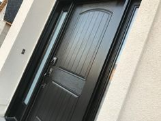 "Front door in Benjamine Moore ""Jet Black"" 2120-10."