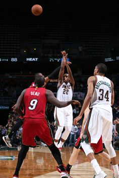 Khris Middleton #22 of the Milwaukee Bucks hits the game winning shot against the Miami Heat on March 24, 2015. (Photo by Gary Dineen/NBAE via Getty Images)