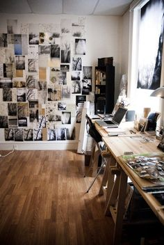 modern chic open workspace with wood butcher block desks and photo wall - graphic designer office space